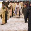 Botezul Domnului, Epifaninia, Botezul marelui fluviu, vegheat de jandarmi și de polițiști la temperaturi de primăvară.